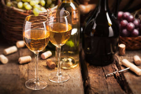 Still life with white wine and grapes photo