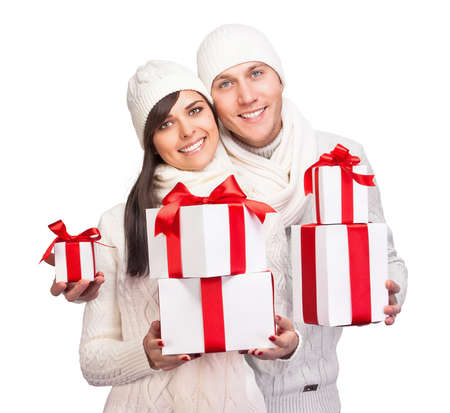 Young couple with Christmas gifts isolated on white background photo