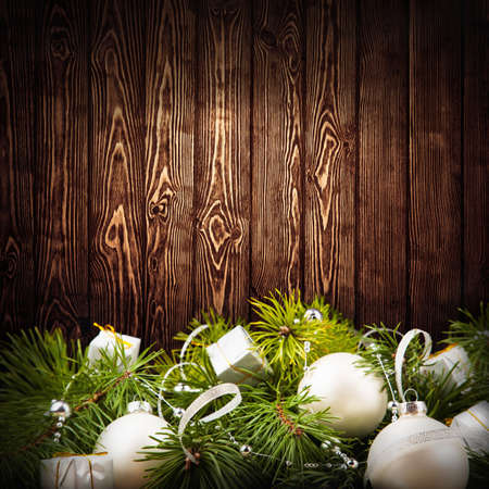 Fir branches with balls on a dark wooden background photo