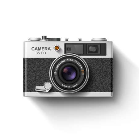 camera film: Retro photo camera with shadow isolated on white.