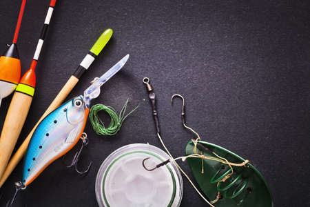 Fishing tackle on dark background 스톡 콘텐츠