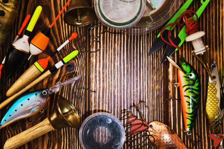 tackle: Fishing tackle on wooden background Stock Photo