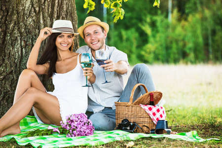 couple nature: Loving couple with wine relaxing on nature Stock Photo