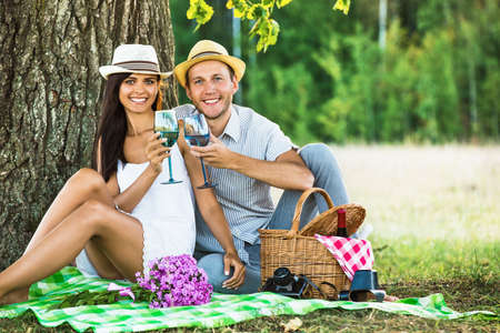 drink food: Loving couple with wine relaxing on nature Stock Photo