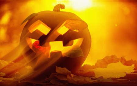 jack o' lantern: Jack O Lantern halloween pumpkin at sunset