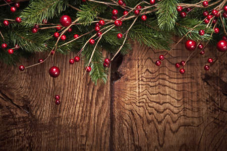 green background: Christmas background with fir branches and berries on wood background