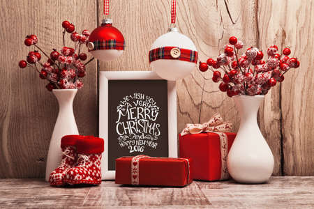 happy holidays: Christmas background with gifts and Christmas balls. Frame with congratulatory text