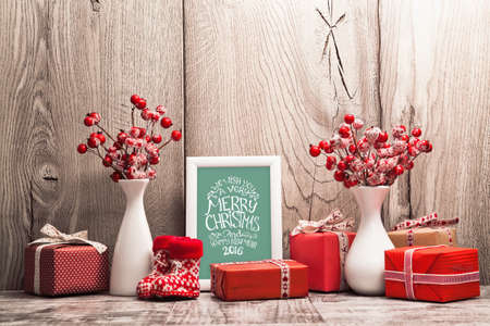 wood texture: Christmas background with gifts and Christmas balls. Frame with congratulatory text