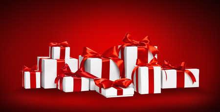 moños navideños: Regalos de Navidad con lazos rojos y cintas sobre fondo rojo Foto de archivo