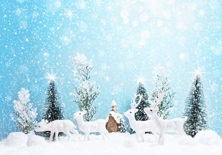 background cover: Winter forest landscape with deer and snow. Christmas background