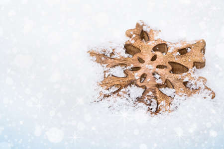 Snowflake on white snowy background with bokeh effect Stock Photo