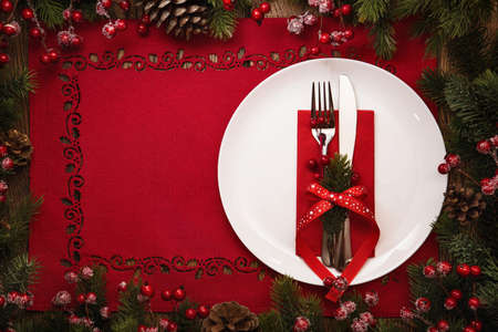 table decoration: Christmas and New Year celebration, served table with fir branches and cones. Holiday food background