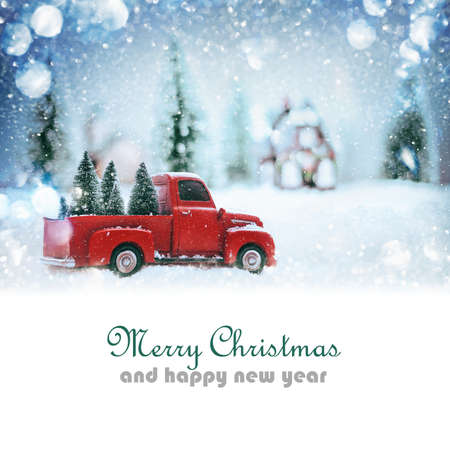 snow road: Pickup with Christmas trees in snow covered forest. Christmas background