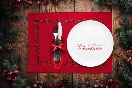 background settings: Christmas and New Year celebration, served table with fir branches and cones. Holiday food background
