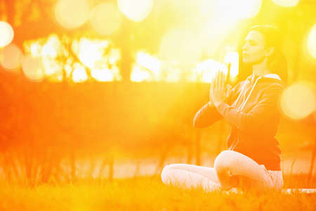 healthy body: Yoga woman meditating at sunset Stock Photo