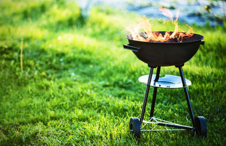 Barbecue grill with fire