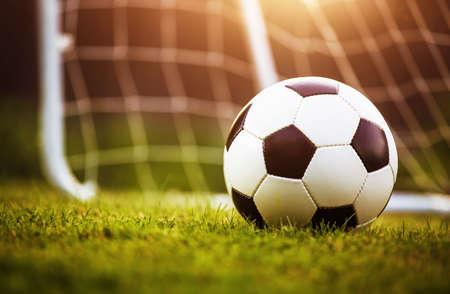 Closeup soccer ball on green grass
