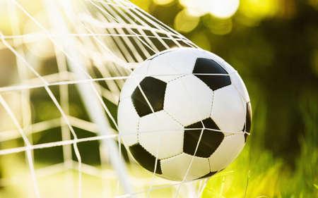 Soccer ball in goal Lizenzfreie Bilder