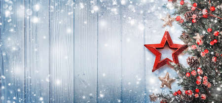 Christmas Decoration with Star and Snowflakes on Wooden Background Lizenzfreie Bilder