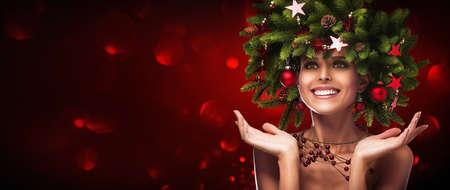 Christmas Hairstyle. Holiday Makeup 写真素材