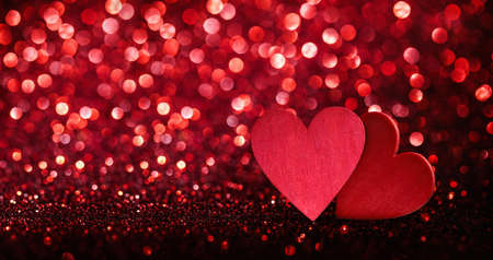 Valentines Day Background. Abstract Red Hearts Holiday Backdrop. Glittering Effect With Red Bokeh Standard-Bild