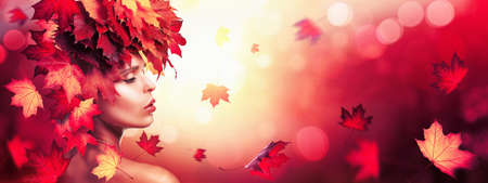 Beautiful High Fashion Woman In Autumn With Falling Leaves Over Nature Background Standard-Bild - 107306515