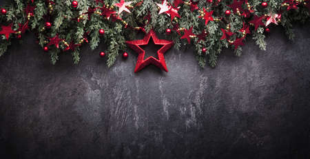 Christmas Decoration With Fir Branches and Red Berries On a Dark Background Standard-Bild - 107941715