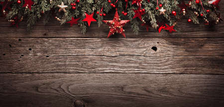 Christmas Fir Tree With Decorations and Red Star On Wooden Background Standard-Bild - 107844094