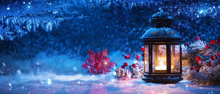 Winter Decoration with a Candlestick Near the Snow-Covered Window. Christmas Background Standard-Bild - 107844095