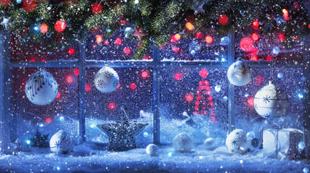 Christmas Decoration With Fir Branches And Balls At The Snow-Covered Window Standard-Bild - 108440127