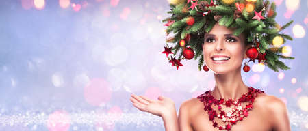 Beauty Fashion Model Girl with Fir Branches Decoration. Winter Hairstyle and Make Up. Surprised girl, Shocking look. Presenting your product Standard-Bild - 109045570