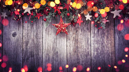 Holidays Decoration Christmas Star on a Wooden Background with Colored Lights Effects Standard-Bild - 109103422