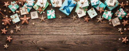 Christmas decorations and gifts on a wooden background Standard-Bild - 109440342