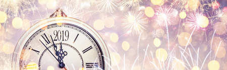 Happy New Year 2019 celebration with dial clock and fireworks. Abstract holiday background Standard-Bild - 109442645