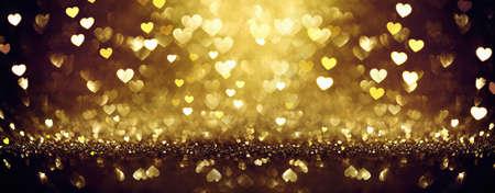Fondo dorado brillante con corazones. Día de San Valentín Foto de archivo