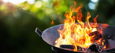 Barbecue grill with fire on nature. Fire flame