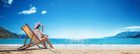 Woman Enjoying Sunbathing at Beach. Summer Vacation Stockfoto