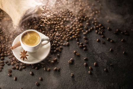 Coffee Cup With Beans On a Dark Background