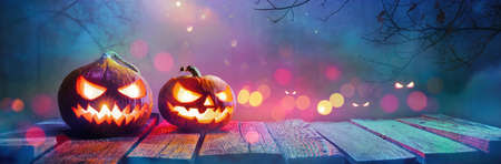 Jack O Lanterns Glowing In Fantasy Night. Halloween Background