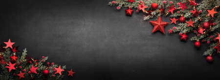 Christmas Decoration With Fir Branches And Red Stars On A Background Stockfoto