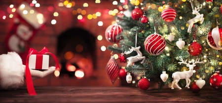 Christmas Tree and a Gift from Santa Claus. Holiday Background