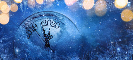 Happy New Years 2020. Winter Celebration With Dial Clock On Snow And Light Imagens