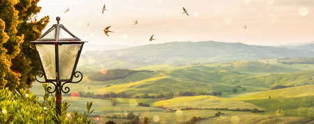 Spring Italian Landscape. Street Lamp on a Morning Sunrise Background. Pienza Italy. Valley Val dOrcia