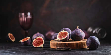 Fresh Figs on Black Background. Beautiful Blue Violet Fruit Close Up
