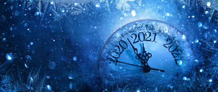 Happy New Years 2021. Winter Celebration With Dial Clock On Snow And Light Standard-Bild