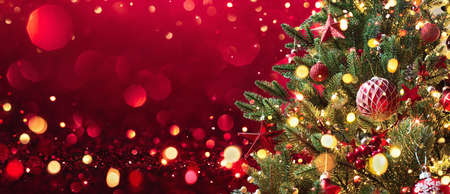 Christmas Tree With Decorations And Glitter. Winter Holiday Background Standard-Bild