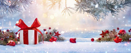 Christmas Holiday Background With Gift And Decorations On A Sunny Background