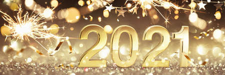Happy New Year 2021. Golden Background with Sparklers and Confetti Standard-Bild