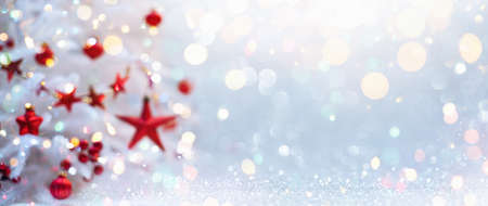 Winter Landscape With Christmas Tree And Red Stars. Holiday Background With Shining Bokeh Effects