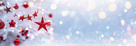 Holiday Background With Christmas Tree And Red Stars. Shining Bokeh Effects Standard-Bild